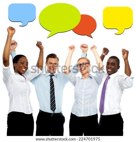 Successful business people with colorful speech bubbles - stock photo