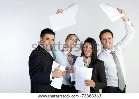 successful business people with documents celebrate - stock photo