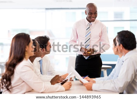Successful business presentation of a man at the office - stock photo