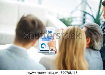 successful business team discussing a financial plan in the offi - stock photo