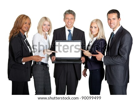 Successful business team displaying a laptop isolated on white background - stock photo
