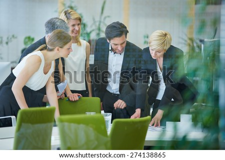 Successful business team doing planning in office meeting - stock photo