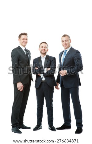 Successful business team. Full length of group of confident businessmen in formal wear standing close to each other. Isolated on white.