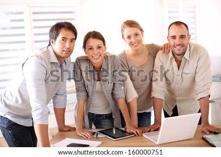 Successful business team in office - stock photo