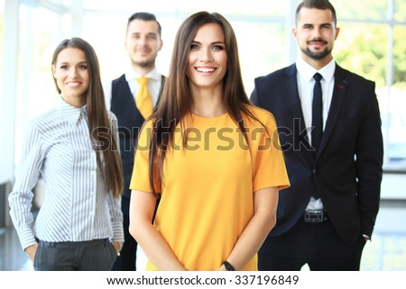 Successful business team smiling at the office - stock photo