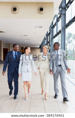 successful business team walking in office - stock photo