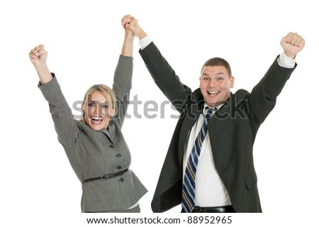 Successful business team with arms in the air isolated on a white background - stock photo