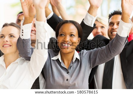 successful business team with arms up - stock photo