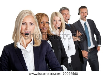 Successful business team with headset on standing in a row against white background - stock photo