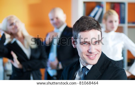 Successful business team with manager in focus - stock photo