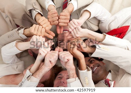 Successful business team with thumbs up lying on the floor in a circle - stock photo