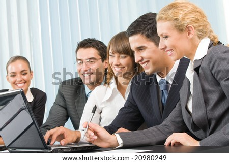 Successful business team working together at office