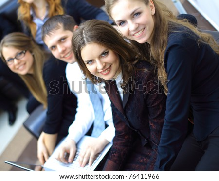 Successful business team working together at office - stock photo
