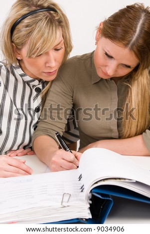 Successful business team working with documents