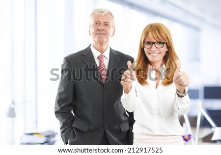 Successful business woman and businessman standing at office. Sales team. - stock photo