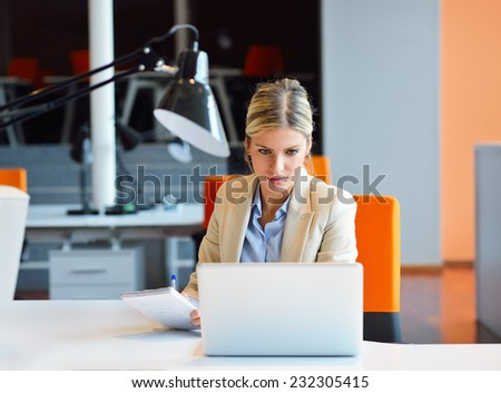 Successful business woman and man working at the office - stock photo