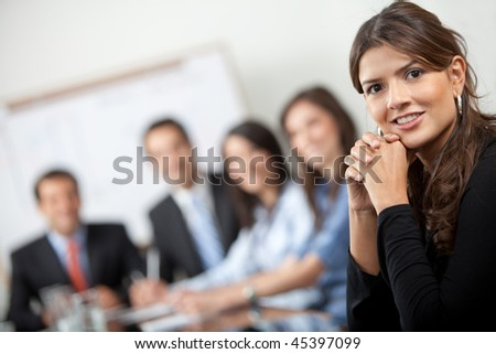 Successful business woman at a corporate meeting