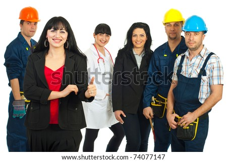 Successful business woman giving thumbs and standing in front of five people with different careers over white background - stock photo