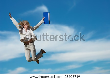Successful business woman holding document folder - stock photo