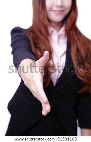 Successful business woman holds out her hand to greet. Isolated over white background - stock photo