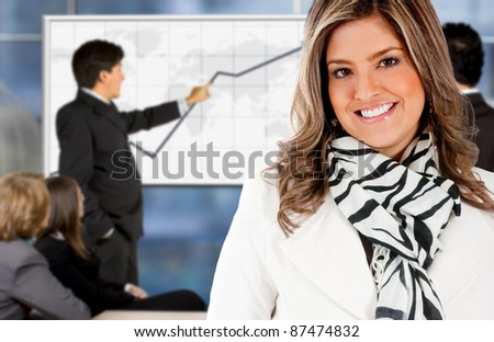 Successful business woman in a meeting with her team - stock photo