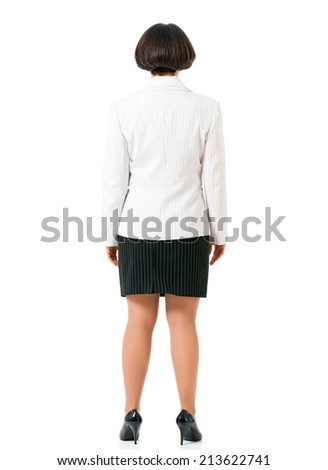 Successful business woman in suit back view, isolated white background