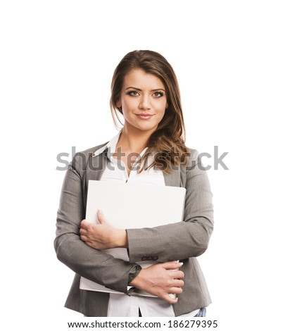 Successful business woman is standing with file folder on isolated background - stock photo