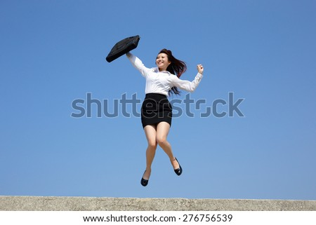 Successful business woman jump and run with blue sky background, full length, asian - stock photo