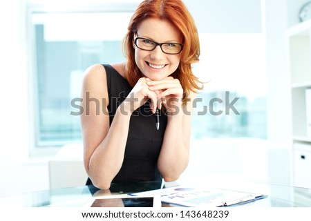 Successful business woman laughing at camera - stock photo