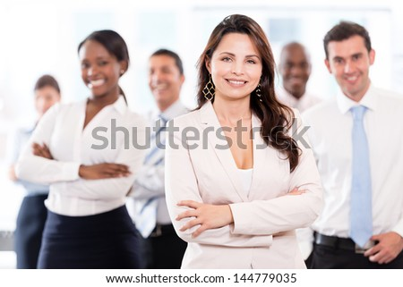Successful business woman leading a group at the office