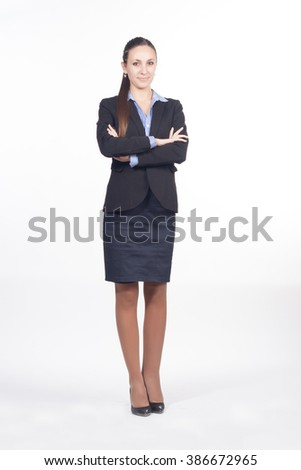Successful business woman looking confident and smiling isolated on white background. Crossed arms.
