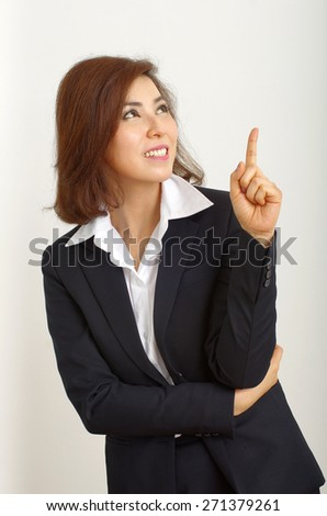 Successful business woman looking up and smiling - stock photo