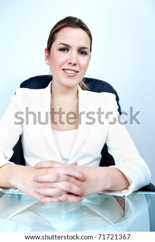 Successful business woman on her desk at the office - stock photo
