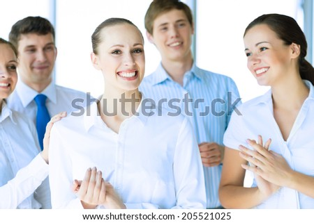Successful business woman receiving congratulations from his colleagues, business success - stock photo