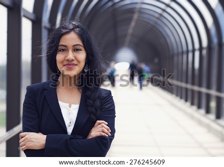 Successful business woman standing on the bridge