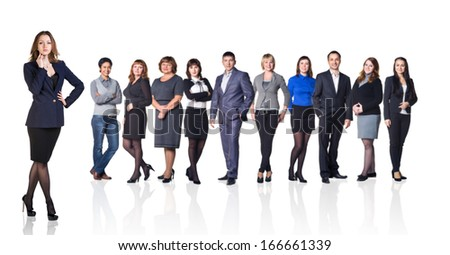 Successful business woman standing with her staff in background isolated on white