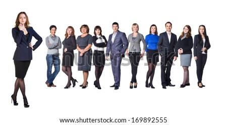 Successful business woman standing with her staff in background isolated on white - stock photo