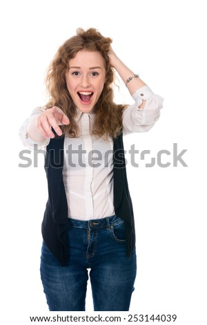 Successful business woman surprised and shows a finger at the camera. Isolated on a white background - stock photo