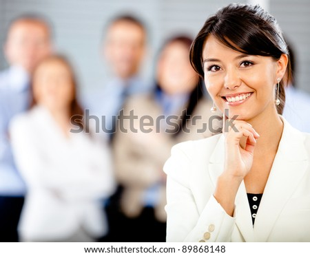 Successful business woman with a corporate group - stock photo