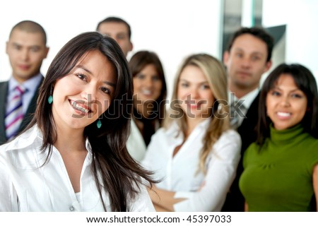 Successful business woman with a group at the office - stock photo