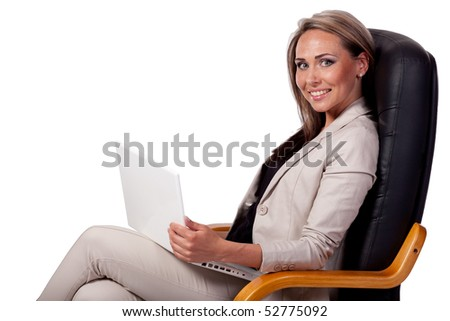 Successful business woman with lap top computer - stock photo