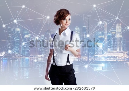 Successful business woman,  with laptop in hand - stock photo