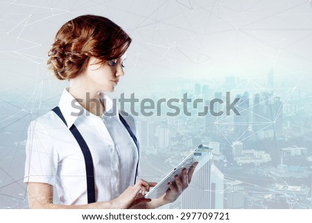 Successful business woman working on laptop, city   background  - stock photo