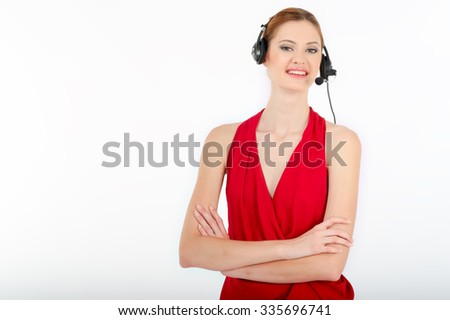 Successful business woman working - she using headphone and computer - stock photo