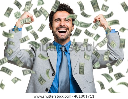 Successful businessman enjoying a rain of money