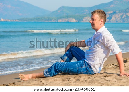 successful businessman free vacation by the sea - stock photo