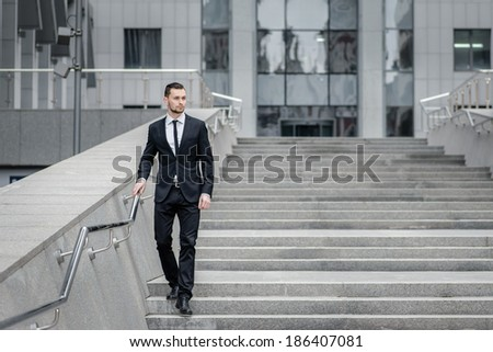 Successful businessman. Full length of cheerful young men in for