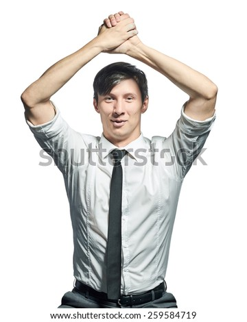 Successful businessman. Happy young man in shirt and tie doing victory gesture and smiling isolated on white background. - stock photo