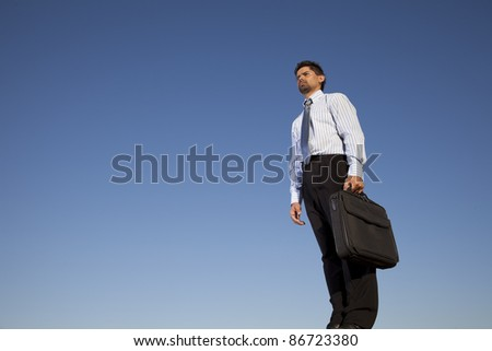 Successful businessman holding a briefcase in outdoor
