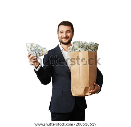 successful businessman holding money and smiling. isolated on white background